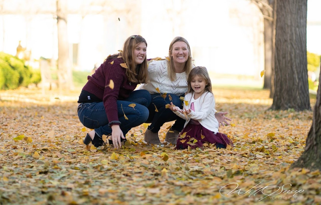 Brey Owen, Olathe KS, Kansas City with her daughter girls just want to have fun leaves